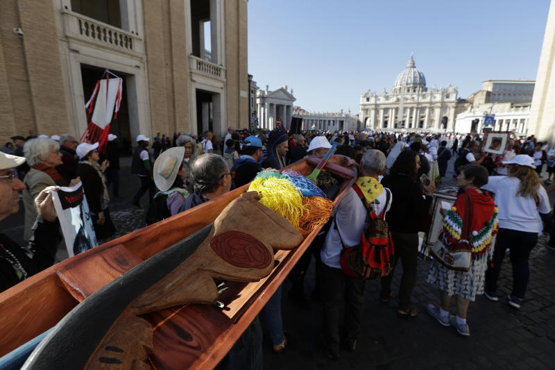 Members of Amazon indigenous populations walk during a Via Crucis (Way of the Cross) procession from St. Angelo Castle to the Vatican, Saturday, Oct. 19, 2019. Pope Francis is holding a three-week meeting on preserving the rainforest and ministering to its native people as he fended off attacks from conservatives who are opposed to his ecological agenda. (AP Photo/Andrew Medichini)