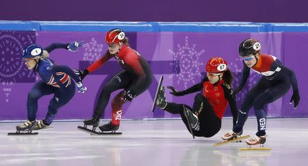 Short Track Speed Skating Events – Pyeongchang 2018 Winter Olympics – Women's 500m Semifinal – Gangneung Ice Arena - Gangneung, South Korea – February 13, 2018 - Elise Christie of Britain leads Kim Boutin of Canada, Qu Chunyu of China and Yara van Kerkhof of the Netherlands. REUTERS/Damir Sagolj