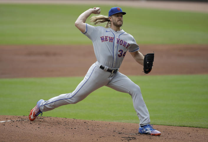 New York Mets pitcher Noah Syndergaard works against the Atlanta Braves in the first inning of a baseball game Sunday, Oct. 3, 2021, in Atlanta. (AP Photo/Ben Margot)