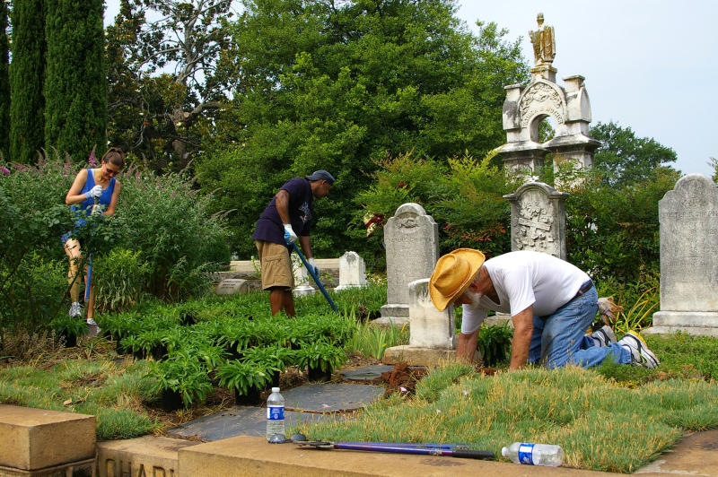 This undated photo, provided by Sara Henderson, volunteers help landscape Oakland Cemetery. In Victorian era cemeteries, it was tradition for families and friends to garden at the graveyard. (Sara Henderson via AP)