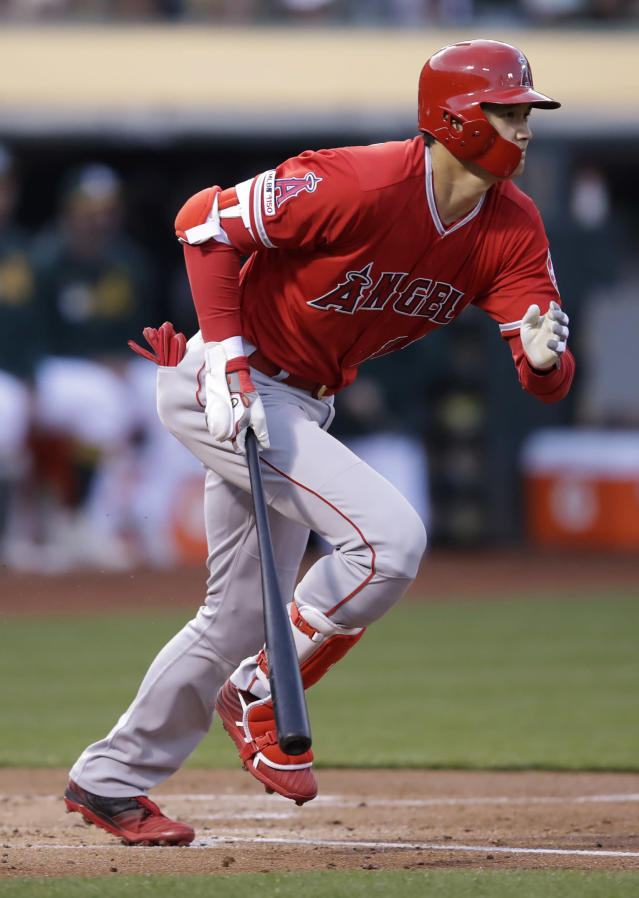 Los Angeles Angels' Shohei Ohtani runs to first base after hitting a single off Oakland Athletics' Frankie Montas in the second inning of a baseball game, Tuesday, May 28, 2019, in Oakland, Calif. (AP Photo/Ben Margot)