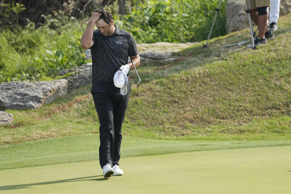 Jon Rahm, of Spain, walks across the 17th green after losing to Scottie Scheffler in their round of eight match at the Dell Technologies Match Play Championship golf tournament Saturday, March 27, 2021, in Austin, Texas. (AP Photo/David J. Phillip)