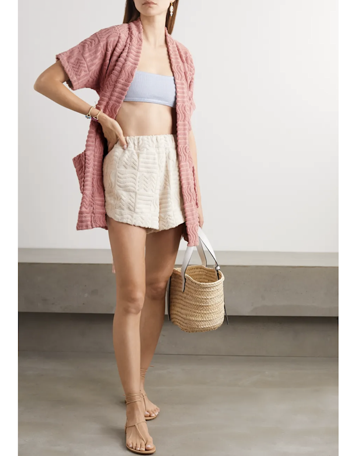 "Keep Lucy Folk's terry cloth robe on deck for the summer. The towel-like fabric makes it perfect for a day lounging by the pool—and we're obsessed with its dusty rose color and geometric motif. $260, Net-a-Porter. <a href=""https://www.net-a-porter.com/en-us/shop/product/lucy-folk/horizon-belted-cotton-terry-robe/1290246"" rel=""nofollow noopener"" target=""_blank"" data-ylk=""slk:Get it now!"" class=""link rapid-noclick-resp"">Get it now!</a>"