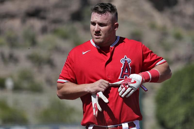 Los Angeles Angels' Mike Trout returns to the dugout.