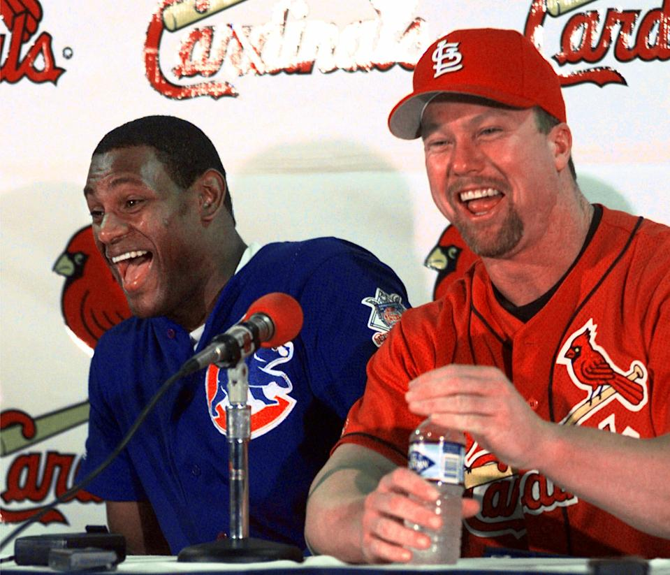 Home run sluggers Sammy Sosa of the Chicago Cubs, left, and St. Louis Cardinals' Mark McGwire laugh together during a news conference in St. Louis, Monday morning,  Sept. 7, 1998. Both men are chasing Roger Maris' major league record of 61 home runs in a season. Heading into Monday's game between the Cubs and Cardinals, McGwire has 60 home runs and Sosa has 58. (AP Photo/Eric Draper)