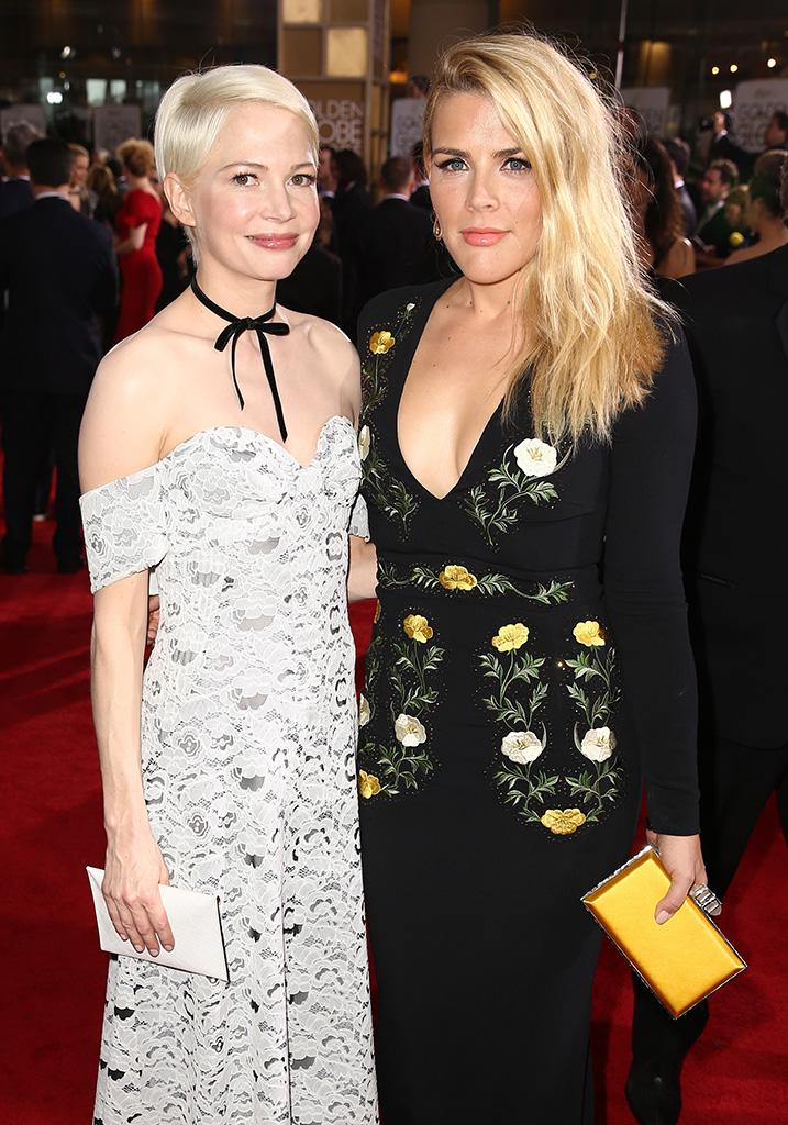 Actresses Michelle Williams and Busy Philipps attend the 74th Annual Golden Globe Awards (Photo: Joe Scarnici/Getty Images for Moet & Chandon )