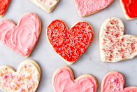 """<p>Heart-shaped cookies with cream cheese frosting are exactly what your Galentine's Day party needs. </p><p><strong>Get the recipe at <a href=""""https://www.delish.com/holiday-recipes/valentines-day/a25811459/heart-shaped-cookies/"""" rel=""""nofollow noopener"""" target=""""_blank"""" data-ylk=""""slk:Delish"""" class=""""link rapid-noclick-resp"""">Delish</a>. </strong></p>"""