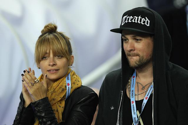 SYDNEY, AUSTRALIA - MAY 11: Nicole Richie and Joel Madden watch the action during the round 12 Super Rugby match between the Waratahs and the Bulls at Allianz Stadium on May 11, 2012 in Sydney, Australia. (Photo by Cameron Spencer/Getty Images)