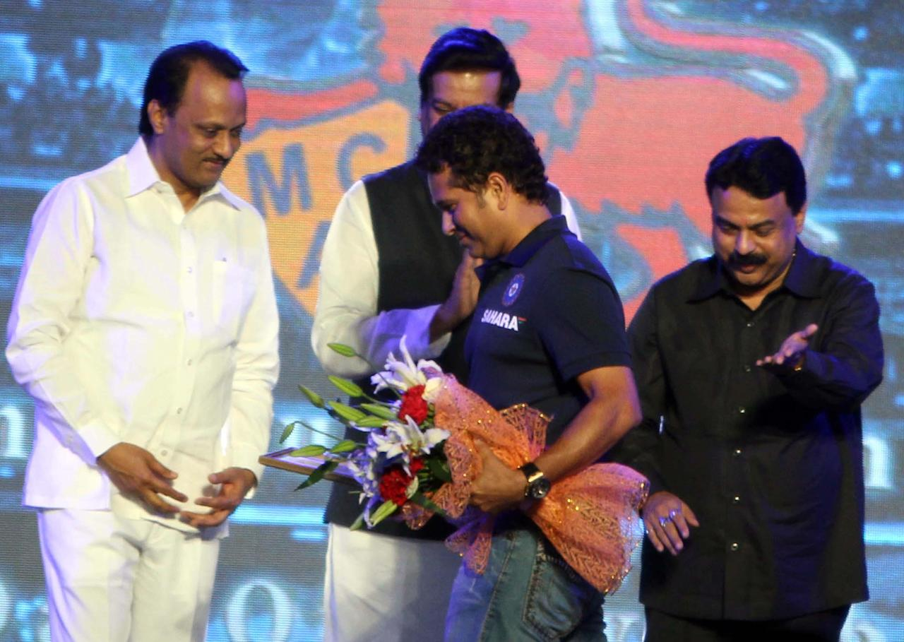 Indian cricketer Sachin Tendulkar and Mumbai Mayor Sunil Prabhu during the rechristening ceremony of MCA sport complex at Kandivali West Mahavir Nagar as `Sachin Tendulkar Gymkhana` in Mumbai on Nov.11, 2013.(Photo: Sandeep Mahankaal/IANS)
