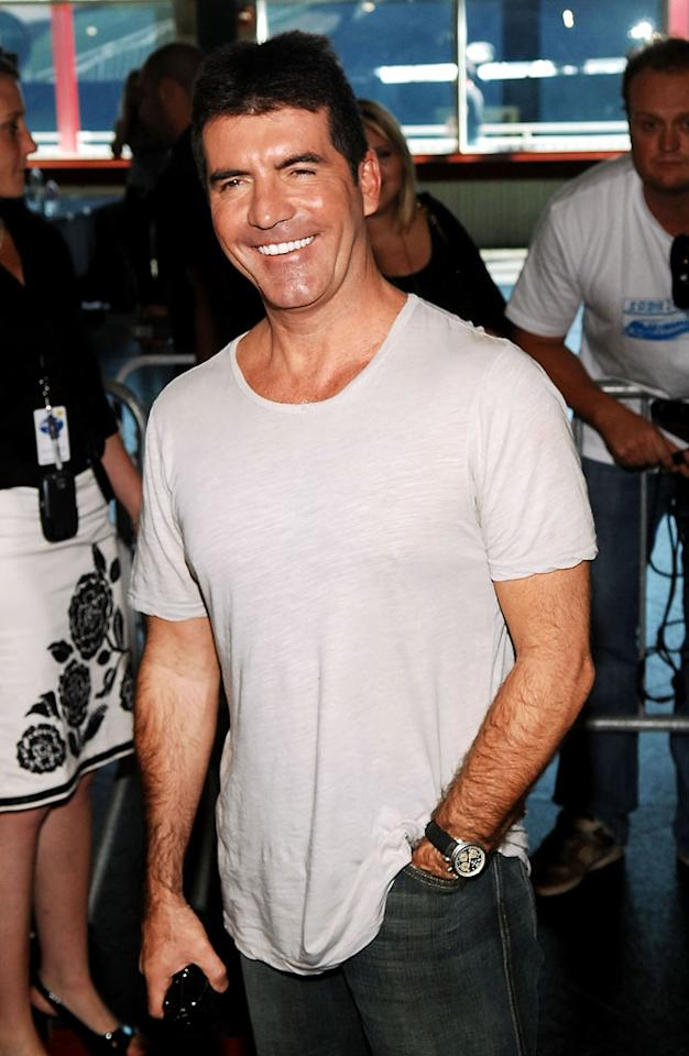 """In 2008, Simon's T-shirts not only goes from black to see-through white, he also brings back the occasional button-front shirt…but fellow judges make fun of how he can't button it (see 2006). Simon's nipples, already part of """"<a href=""""/american-idol/show/34934"""">Idol</a>"""" lore, <a href=""""http://www.vh1.com/news/articles/1584907/20080407/cyrus__miley.jhtml"""" rel=""""nofollow"""">are lampooned</a> during the """"Idol Gives Back"""" charity episode. Everyone — the singers, the host, and his fellow judges — are ganging up against him, and he has to issue another momentous apology to contestant David Cook in the finals for criticism that was """"verging on disrespectful."""" The crazy mood reflects the whole seesaw seventh season, with ratings hitting historic lows before leaping to the biggest finale numbers in Fox history. On the personal front, Simon and longtime gal pal Terri Seymour breaks up. But Cowell's battle of the bulge earned him a swimsuit spread in the Daily Mail later that year. Said Cowell, """"<a href=""""http://www.dailymail.co.uk/tvshowbiz/article-1101851/Simon-Cowells-got-Xmas-factor-shows-buff-body-beach.html#ixzz0otKmB9Tl"""" rel=""""nofollow"""">I am vain but I cannot think of one person on TV who is not. It is the nature of the beast…I have had Botox but not in an obsessive way. I just like to take care of myself. I am eating a lot better and have cut out the chocolate biscuits and crisps</a>."""""""