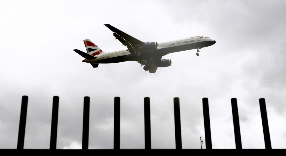 An aircraft prepares to land at Heathrow airport in London March 11, 2008. London's crowded Heathrow airport could almost double airline charges in the next five years, boosting its debt-laden Spanish owner but sparking fury among airlines that fly from there.      REUTERS/Alessia Pierdomenico (BRITAIN)