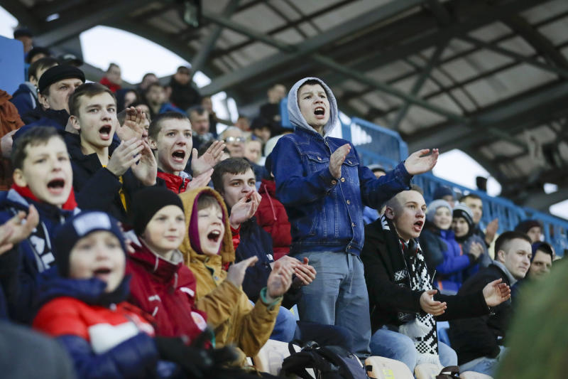 Young fans react during a Belarus soccer match on March 27. Longtime Belarus President Alexander Lukashenko is proudly keeping soccer and hockey arenas open even though most sports around the world have shut down because of the coronavirus pandemic. (Sergei Grits / AP)