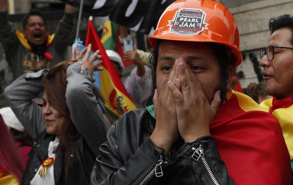 Opponents of Bolivia's President Evo Morales celebrate after he announced his resignation, in La Paz, Bolivia, Sunday, Nov. 10, 2019. Morales resigned Sunday under mounting pressure from the military and the public after his re-election victory triggered weeks of fraud allegations and deadly protests. (AP Photo/Juan Karita)