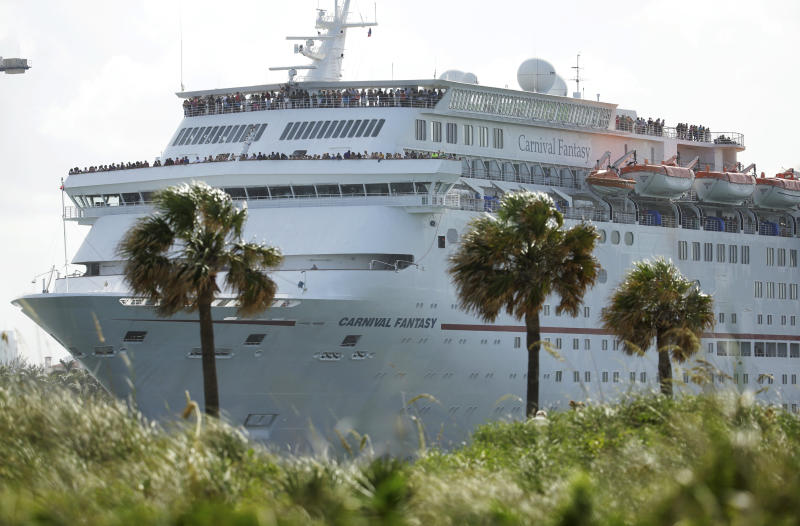 FILE - In this Monday, June 20, 2016, file photo, the Carnival Fantasy cruise ship leaves PortMiami, in Miami Beach, Fla. Top Carnival Corp. executives are due back in court to explain what the world's largest cruise line is doing to reduce ocean pollution. A hearing is set Wednesday, Oct. 2, 2019, in Miami federal court for an update on what steps Carnival is taking. (AP Photo/Lynne Sladky, File)