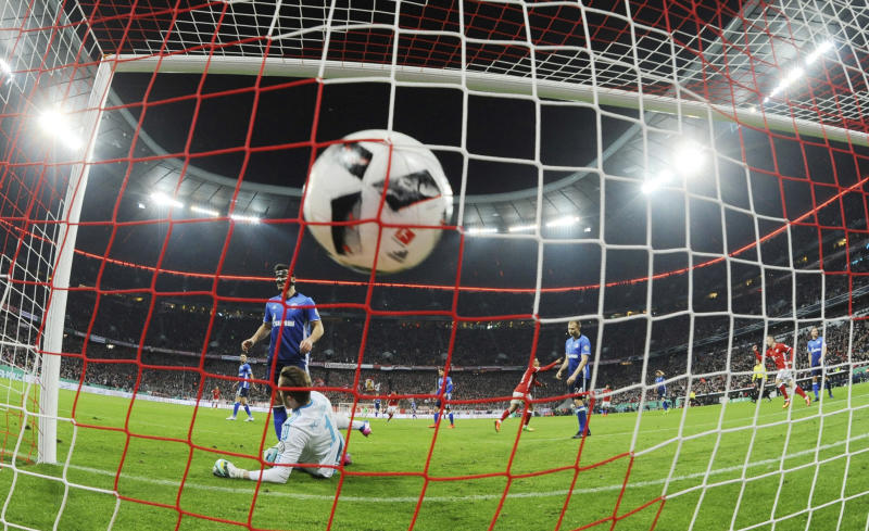 Schalke goalkeeper, Ralf Faehrmann, lies in front of the goal after Bayern's Thiago scores, during the German soccer cup quarter final match between Bayern Munich and FC Schalke 04 in the Allianz Arena in Munich, Germany, Wednesday, March 1, 2017. (Tobias Hase/DPA via AP)
