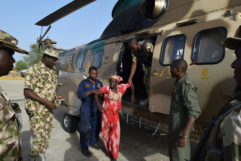 Amina Ali seen alighting from a Nigerian Army helicopter after her release on May 18, 2016 in Damboa, Nigeria