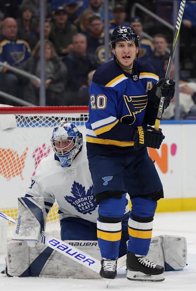 Toronto Maple Leafs goaltender Frederik Andersen tries to see around St. Louis Blues' Alexander Steen during the second period of an NHL hockey game Tuesday, Feb. 19, 2019, in St. Louis. (AP Photo/Tom Gannam)