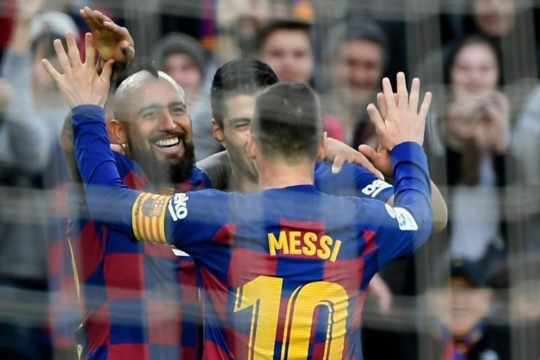 Arturo Vidal and Luis Suarez celebrate after Lionel Messi's goal