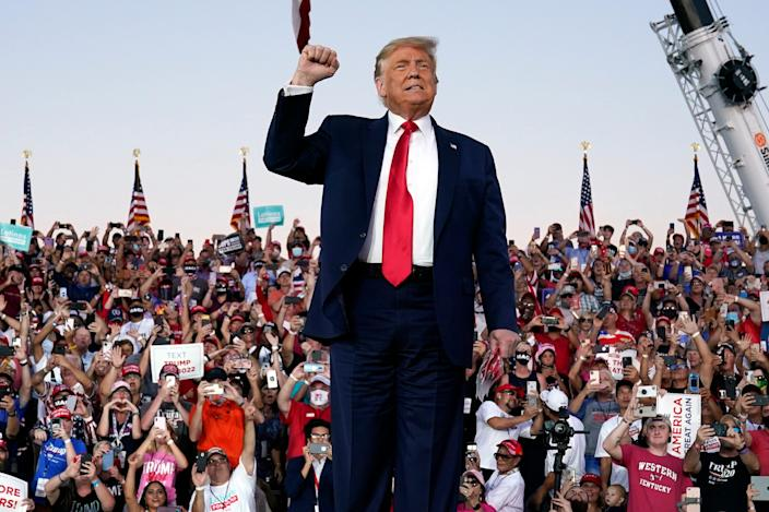President Donald Trump arrives for a campaign rally at Orlando Sanford International Airport on Monday. Heading into the second-to-last week of the presidential campaign, the Real Clear Politics average of Florida polls has Trump trailing Joe Biden by 2.7 percentage points and surveys consistently show Trump's support is down among seniors.