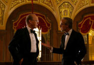 """This image released by Netflix shows Michael Keaton, left, and Stanley Tucci in a scene from """"Worth."""" (Netflix via AP)"""