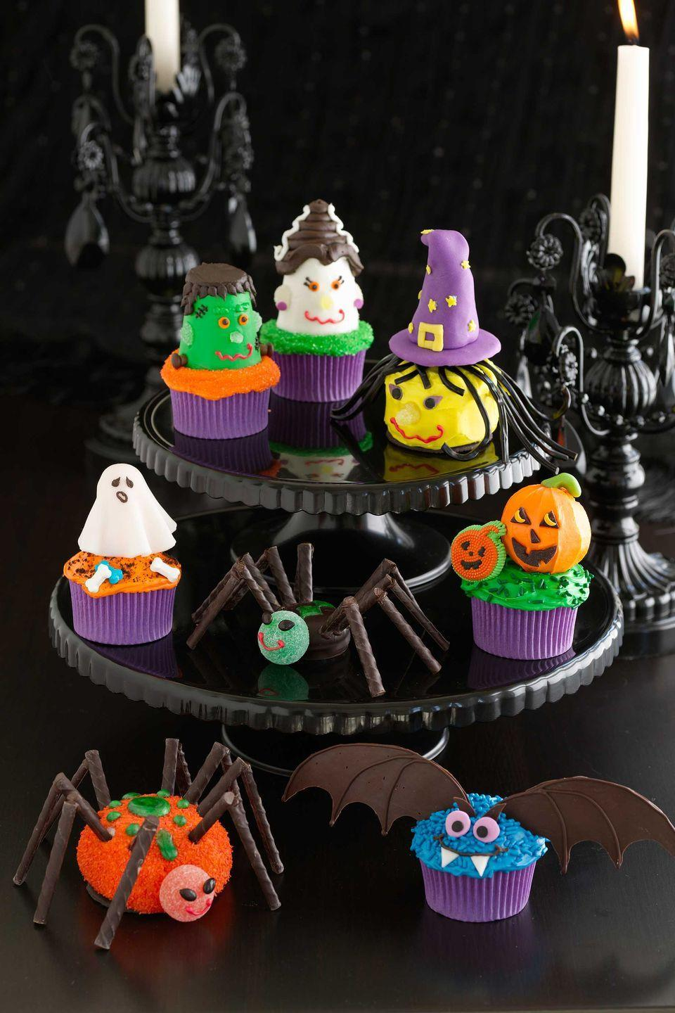 """<p>You'll never know if this witch is nice or evil because you'll be too busy enjoying her neon fondant hat, licorice hair, confetti pupils, and gumdrop nose.</p><p><a href=""""https://www.womansday.com/food-recipes/food-drinks/recipes/a10933/witch-cupcakes-122193/"""" rel=""""nofollow noopener"""" target=""""_blank"""" data-ylk=""""slk:Get the Witch Cupcakes recipe."""" class=""""link rapid-noclick-resp""""><em>Get the Witch Cupcakes recipe.</em></a></p>"""