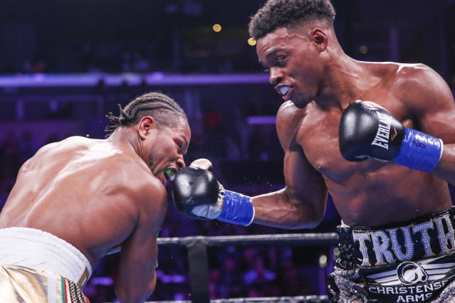 Errol Spence Jr. (R) lands a punch against Shawn Porter during the WBC & IBF World Welterweight Championship boxing match Saturday, Sept. 28, 2019, in Los Angeles. (AP Photo/Ringo H.W. Chiu)
