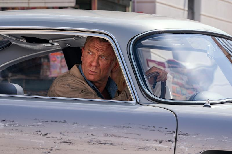 James Bond (Daniel Craig) and Dr. Madeleine Swann (Léa Seydoux) drive through Matera, Italy in NO TIME TO DIE. (Credit: Nicola Dove © 2019 DANJAQ, LLC AND MGM)
