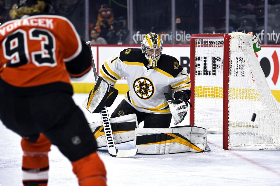 Boston Bruins goaltender Jeremy Swayman watches the puck after making a save during the first period of an NHL hockey game against the Philadelphia Flyers, Saturday, April 10, 2021, in Philadelphia. (AP Photo/Derik Hamilton)