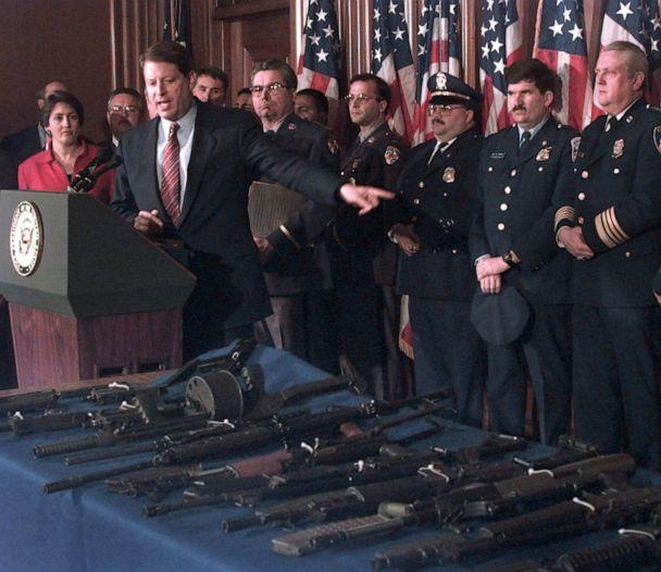 PHOTO: Vice President Al Gore, flanked by Deputy Attorney General Jaime Gorelick, far left, and Maryland Police Superintendent David Mitchell, gestures toward various assault weapons during a news conference in Washington D.C., March 22, 1996. (Dennis Cook/AP)
