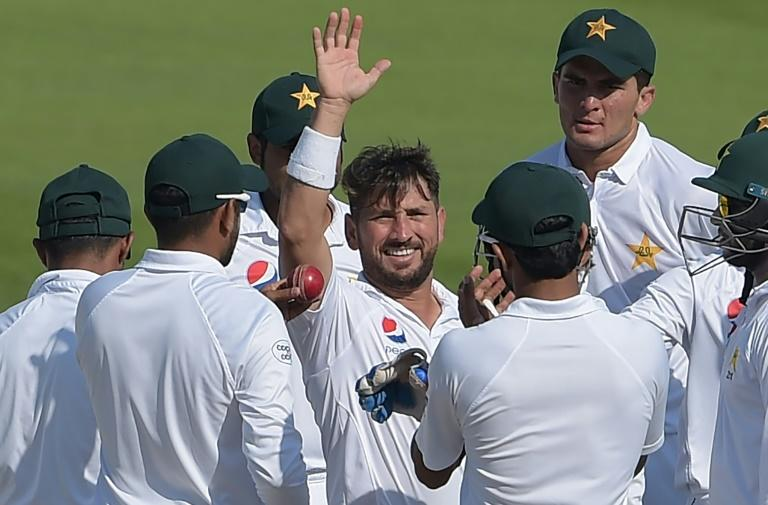 Record breaker: Pakistani spinner Yasir Shah celebrates taking his 200th Test wicket against New Zealand on Thursday