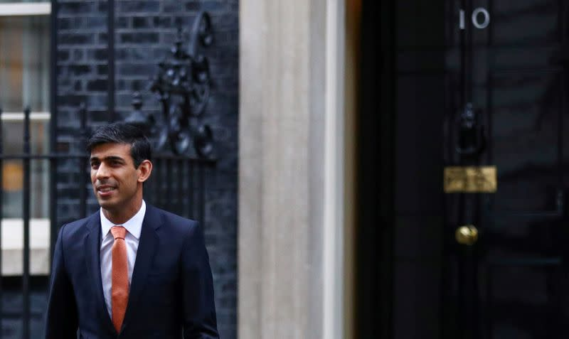 FILE PHOTO: Newly appointed Britain's Chancellor of the Exchequer Rishi Sunak leaves Downing Street 10 in London