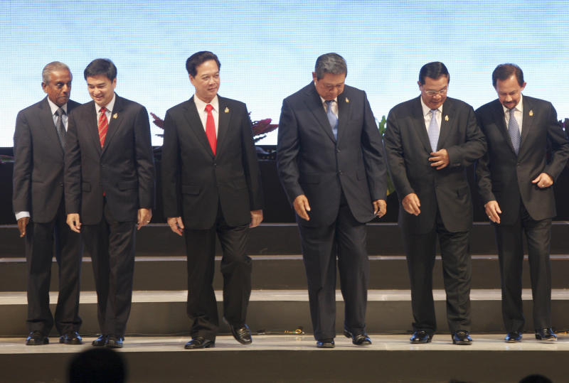 Head of states and governments of the Association of Southeast Asia Nation, from left, Singapore's Senior Minister S. Jayakumar, Thai Prime Minister Abhisit Vejjajiva, Vietnamese Prime Minister Nguyen Tan Dung, Indonesian President Susilo Bambang Yudhoyono, Cambodian Prime Minister Hun Sen, Brunei's Sultan Hassanal Bolkiah leave the stage after posing for a group photo during the opening ceremony of the 18th ASEAN Summit in Jakarta, Indonesia, Saturday, May 7, 2011. (AP Photo/Dita Alangkara)