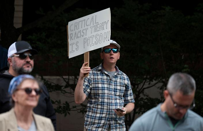 A protester holding a sign saying