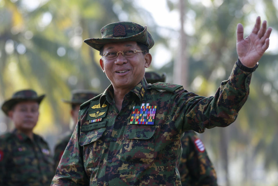 Myanmar military commander-in-chief Senior General Min Aung Hlaing gestures as he arrives to attend the second day of 'Sin Phyu Shin' joint military exercises, Saturday, Feb. 3, 2018, in Ayeyarwaddy delta region, Myanmar. The two-day military exercise is the biggest since 1997, involving several different armed forces. (Lynn Bo Bo/Pool Photo via AP)