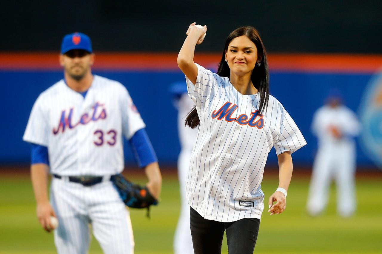 NEW YORK, NY - APRIL 27:  Miss Universe 2015 Pia Wurtzbach throws out the ceremonial first pitch of a game between the New York Mets and the Cincinnati Reds as Matt Harvey #33 looks on at Citi Field on April 27, 2016 in the Flushing neighborhood of the Queens borough of New York City.  (Photo by Jim McIsaac/Getty Images)
