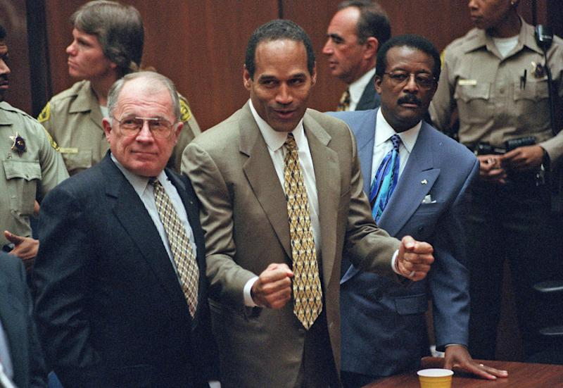 FILE - In this Oct. 3, 1995 file photo, O.J. Simpson, center, reacts as he is found not guilty of murdering his ex-wife Nicole Brown and her friend Ron Goldman, as members of his defense team, F. Lee Bailey, left, and Johnnie Cochran Jr., right, look on, in court in Los Angeles. The return of O.J. Simpson to a Las Vegas courtroom next Monday, May, 13, will remind Americans of a tragedy that became a national obsession and in the process changed the country's attitude toward the justice system, the media and celebrity. The return of O.J. Simpson to a Las Vegas courtroom next Monday, May, 13, will remind Americans of a tragedy that became a national obsession and in the process changed the country's attitude toward the justice system, the media and celebrity.(AP Photo/Pool, Myung J. Chun, file)