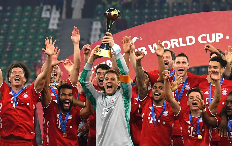 DOHA, QATAR - FEBRUARY 11: Manuel Neuer of FC Bayern Muenchen lifts the FIFA Club World Cup Qatar 2020 trophy as FC Bayern Muenchen celebrate after winning the FIFA Club World Cup Qatar 2020 Final between FC Bayern Muenchen and Tigres UANL at the Education City Stadium on February 11, 2021 in Doha, Qatar. (Photo by David Ramos - FIFA/FIFA via Getty Images)