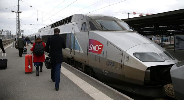 Commuters walks past a TGV high speed train at a railway station in Nantes, France, March 21, 2018. REUTERS/Stephane Mahe