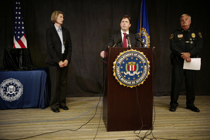 """FBI Special Agent Jill Sanborn, left, and Grand Rapids Police Chief Scott Johnson, right, listen as U.S. Attorney Christopher Myers speaks during a news conference, Tuesday, Sept. 4, 2018, at the FBI office in Brooklyn Center, Minn., regarding the recovery of pair of ruby slippers once worn by actress Judy Garland in the """"The Wizard of Oz."""" Authorities announced that the slippers, stolen in 2005 from the Judy Garland Museum in Grand Rapids, Minn., were recovered in a sting operation. The FBI says it has multiple suspects in the extortion and that the investigation continues. Four pairs of ruby slippers worn by Garland in the movie are known to exist. (Richard Tsong-Taatarii/Star Tribune via AP)"""