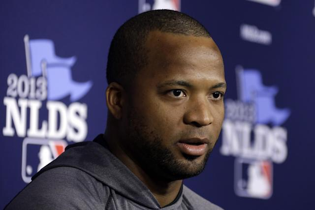 Pittsburgh Pirates starting pitcher Francisco Liriano answers a question during a press conference before a baseball workout in Pittsburgh, Saturday, Oct. 5, 2013. Liriano is scheduled to start Game 3 of the National League division series against the St. Louis Cardinals on Sunday. (AP Photo/Gene J. Puskar)