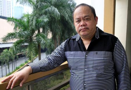 REFILE - CORRECTING GRAMMAR Filipino lawyer Jude Sabio poses for a picture in Metro Manila, Philippines February 10, 2018. Picture taken February 10, 2018. REUTERS/Romeo Ranoco