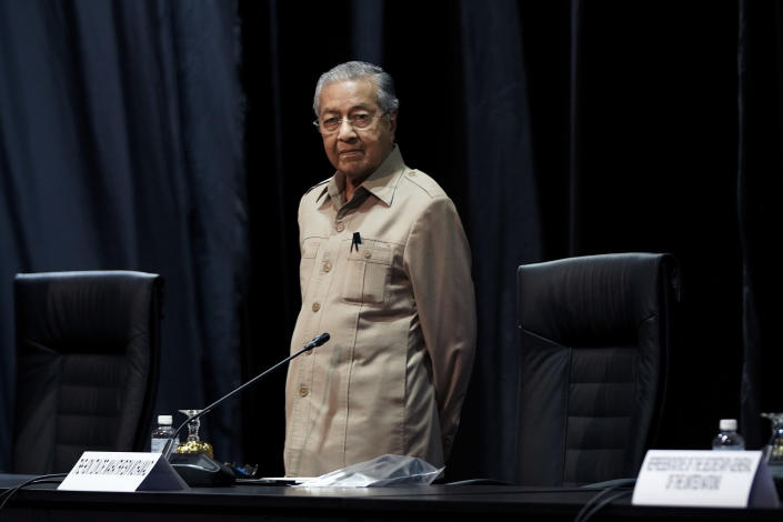 Malaysia's interim leader Mahathir Mohamad attends the committee on the exercise of the inalienable rights of the Palestinian people, in Kuala Lumpur, Malaysia, Friday, Feb. 28, 2020. The speaker of Malaysia's House rejected Mahathir Mohamad's call for a vote next week to chose a new premier, deepening the country's political turmoil after the ruling alliance collapsed this week. (AP Photo/Vincent Thian)