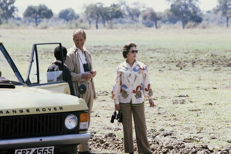 Queen Elizabeth II and Prince Philip on safari during their state visit to Zambia, 1979. Photo by Serge Lemoine/Getty Images.