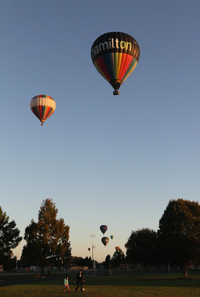 Hot air balloons rise as they leave Innes Common Park on March 29, 2012 in Hamilton, New Zealand. Each Autumn over 30 hot air balloons grace the sky as part of the Balloons Over Waikato Festival.  (Photo by Sandra Mu/Getty Images)
