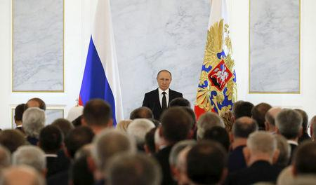 FILE PHOTO: Russian President Vladimir Putin addresses the Federal Assembly, including State Duma deputies, members of the Federation Council, regional governors and civil society representatives, at the Kremlin in Moscow, Russia December 3, 2015. REUTERS/Sergei Karpukhin/File Photo