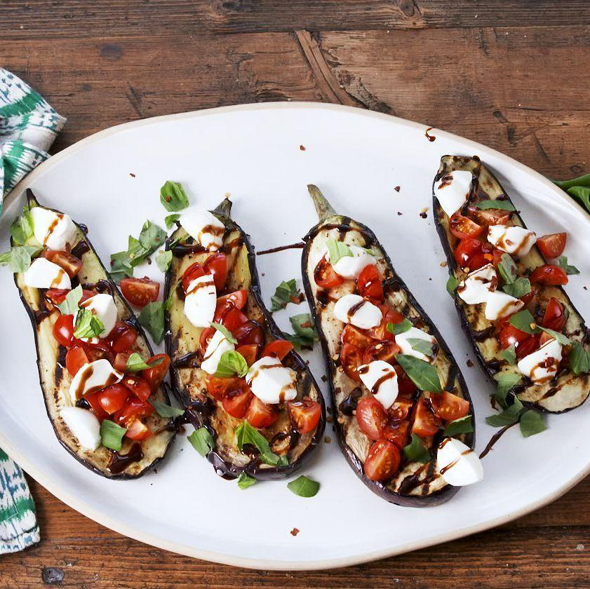 """<p>For those nights when we really need a vegetable in our lives, we turn to these aubergine steaks. They grill up quickly with minimal prep for a delicious <a href=""""https://www.delish.com/uk/cooking/recipes/g32768299/easy-dinner-recipes/"""" rel=""""nofollow noopener"""" target=""""_blank"""" data-ylk=""""slk:weeknight dinner"""" class=""""link rapid-noclick-resp"""">weeknight dinner</a>! Perfect for your next meatless Monday. </p><p>Get the <a href=""""https://www.delish.com/uk/cooking/recipes/a35222945/caprese-eggplant-steaks-recipe/"""" rel=""""nofollow noopener"""" target=""""_blank"""" data-ylk=""""slk:Caprese Aubergine Steaks"""" class=""""link rapid-noclick-resp"""">Caprese Aubergine Steaks</a> recipe.</p>"""