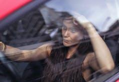woman seething behind the wheel of a car