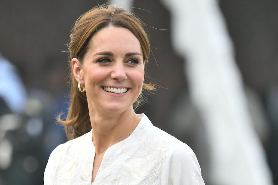 LAHORE, PAKISTAN - OCTOBER 17: Catherine, Duchess of Cambridge smiles during a visit of the National Cricket Academy with Prince William, Duke of Cambridge on October 17, 2019 in Lahore, Pakistan. Their Royal Highnesses The Duke and Duchess of Cambridge are on a visit of Pakistan between 14-18th October at the request of the Foreign and Commonwealth Office. (Photo by Samir Hussein/WireImage)