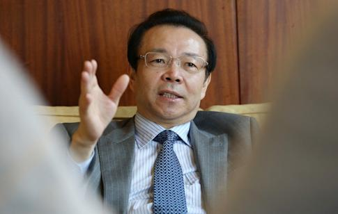 Former Huarong Chairman & Executive Director Lai Xiaomin speaks during an interview in Hong Kong in 2016. Lai has subsequently faced trial for corruption. Photo: May Tse