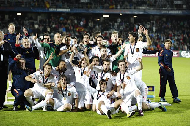 Spanish players celebrate with the trophy after winning the UEFA Under-21 European Championship final football match against Switzerland at NRGI Park Stadium in Arhus Stadion Denmark Saturday June 25, 2011. AFP PHOTO HENNING BAGGER/SCANPIX (Photo credit should read HENNING BAGGER/AFP/Getty Images)